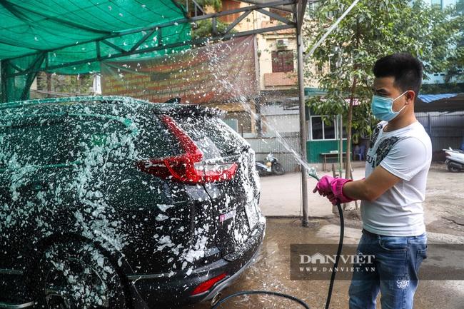 30 Tết tranh thủ ở Hà Nội rửa xe kiếm 30 triệu đồng - Ảnh 4.