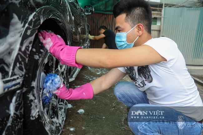 30 Tết tranh thủ ở Hà Nội rửa xe kiếm 30 triệu đồng - Ảnh 5.
