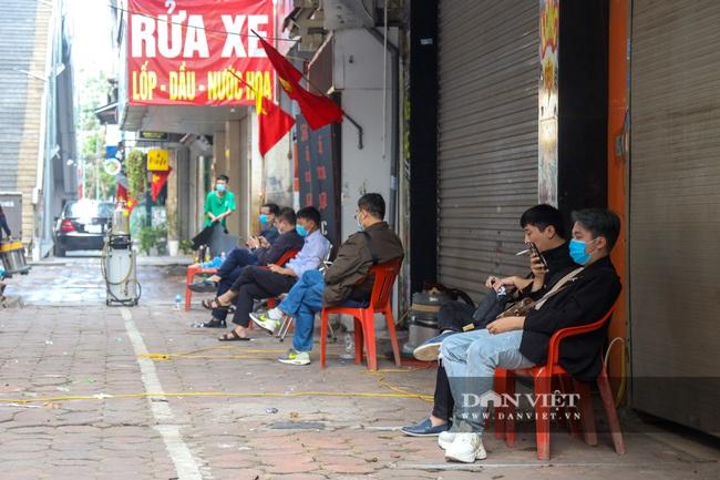 30 Tết tranh thủ ở Hà Nội rửa xe kiếm 30 triệu đồng - Ảnh 7.
