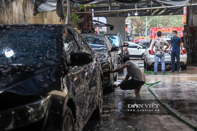 30 Tết tranh thủ ở Hà Nội rửa xe kiếm 30 triệu đồng - Ảnh 8.