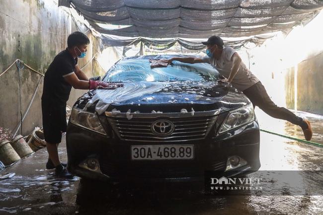 30 Tết tranh thủ ở Hà Nội rửa xe kiếm 30 triệu đồng - Ảnh 9.