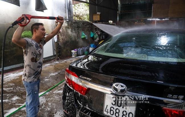 30 Tết tranh thủ ở Hà Nội rửa xe kiếm 30 triệu đồng - Ảnh 11.