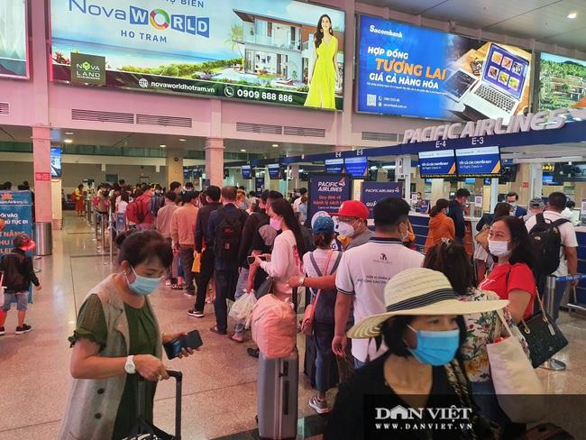 Giỗ tổ Hùng Vương: Sân bay Tân Sơn Nhất đông, hết ùn tắc nghiêm trọng ở cửa soi chiếu an ninh - Ảnh 3.