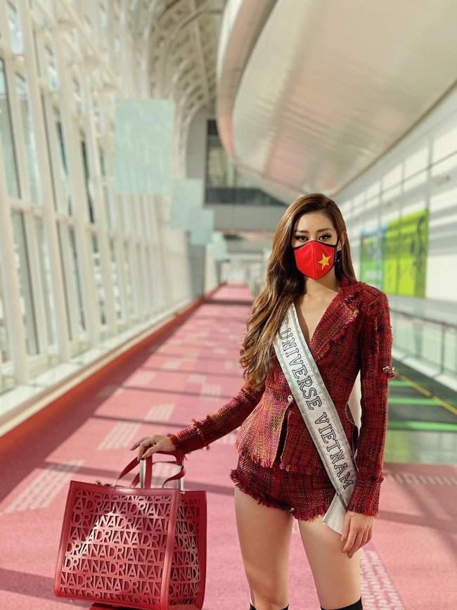 """Ảnh: Khánh Vân khẩu trang kín mít """"vượt bão"""" Covid lên đường chinh phục Miss Universe - Ảnh 13."""