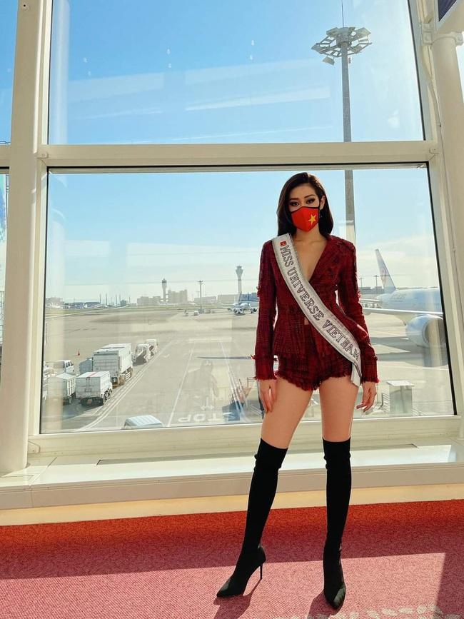 """Ảnh: Khánh Vân khẩu trang kín mít """"vượt bão"""" Covid lên đường chinh phục Miss Universe - Ảnh 12."""