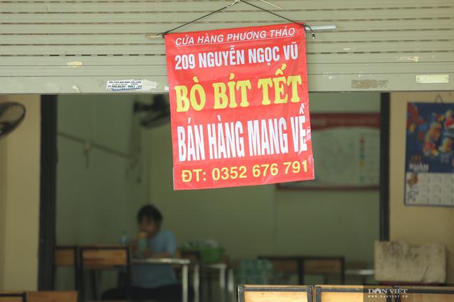 Hà Nội: Hàng quán bán hàng mang về, dịch vụ ship đồ ăn tận nhà được mùa nở rộ - Ảnh 9.