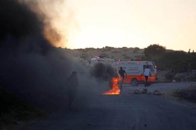 Israel đánh bom nhà thủ lĩnh Hamas, Tel Aviv hứng mưa tên lửa - Ảnh 1.