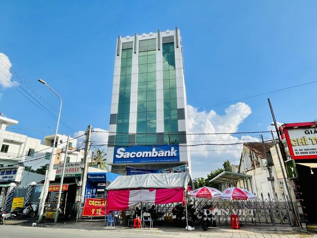 Bình Dương thêm 14 ca mắc Covid-19, tạm thời phong tỏa chi nhánh ngân hàng Sacombank  - Ảnh 1.