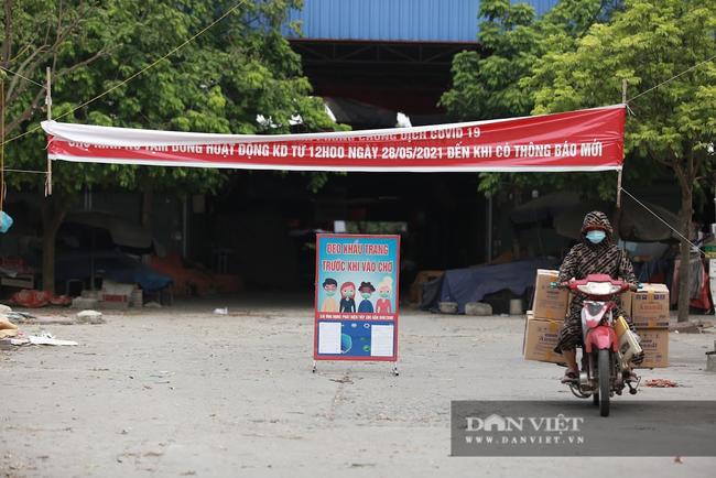 Hà Nội thêm 1 người phụ nữ bán rau ở huyện Đông Anh dương tính với SARS-CoV-2 - Ảnh 1.