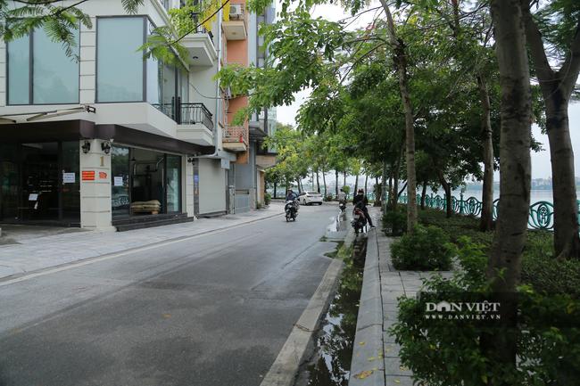 Hà Nội: Hồ Tây vắng vẻ lạ thường sau quy định mới - Ảnh 2.