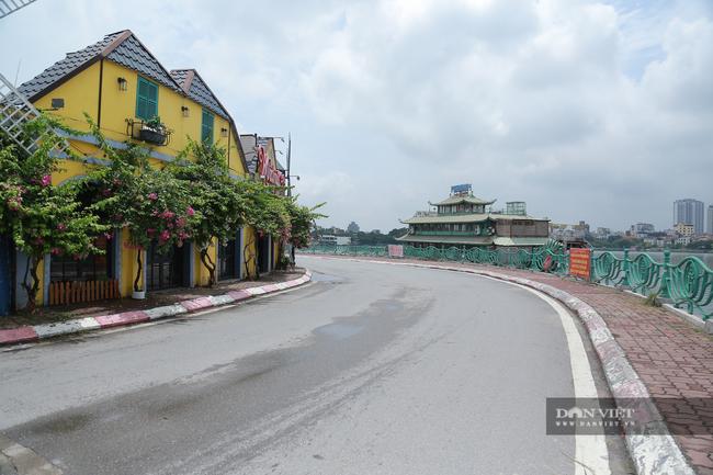 Hà Nội: Hồ Tây vắng vẻ lạ thường sau quy định mới - Ảnh 4.