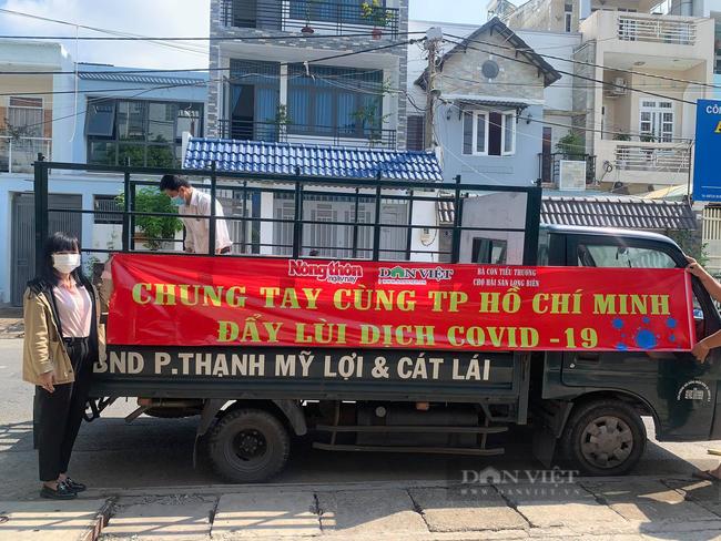 Báo Nông thôn Ngày nay/Dân Việt trao quà của bạn đọc đến người dân bị ảnh hưởng dịch Covid-19 ở TP.HCM - Ảnh 7.