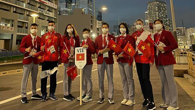 CHÙM ẢNH: Đoàn Việt Nam diễu hành tại lễ khai mạc Olympic 2020 - Ảnh 7.
