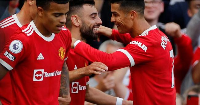 Chùm ảnh: Ronaldo ra mắt, M.U nhuộm đỏ thành Manchester - Ảnh 1.