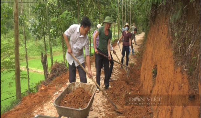 Yên Bái: Vì sao nông dân nơi đây lại bỏ tiền túi đóng góp làm đường giao thông nông thôn - Ảnh 1.