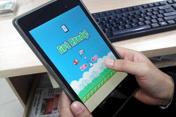 Tác giả Flappy Bird đã bị nghi ngờ nhiều khi đưa ra lý do gỡ bỏ 'con đẻ' của mình. (Ảnh: N.K/Vietnam+)