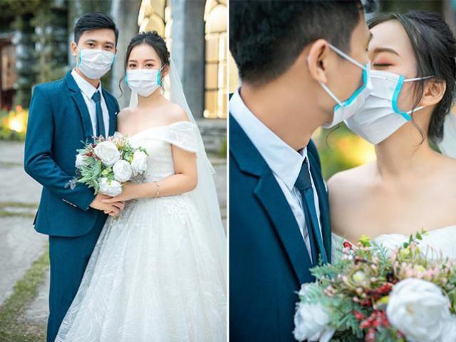 Giữa tâm dịch Corona, cặp đôi Việt đeo kín khẩu trang chụp ảnh cưới