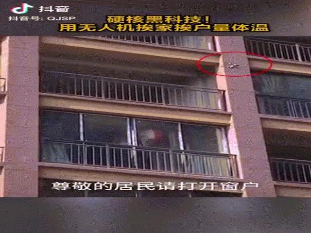 Máy bay không người lái TQ dừng giữa không trung đo nhiệt độ người dân trong căn hộ