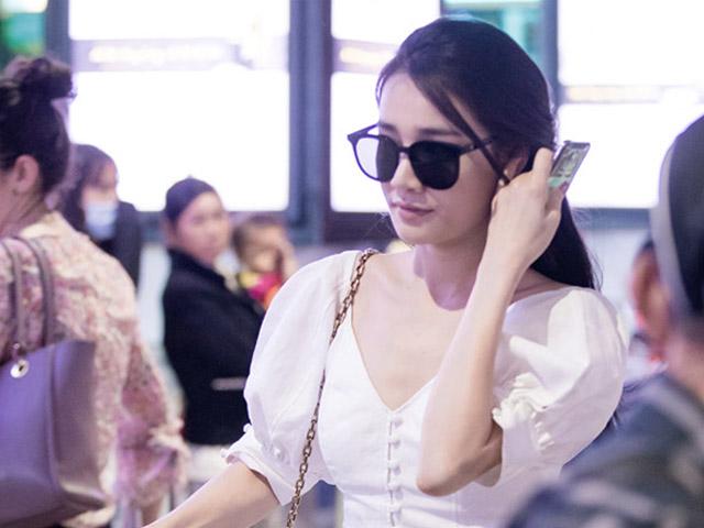 Nhã Phương lặng lẽ về Sài Gòn, cúi đầu ngó lơ khi bị chú ý tại sân bay