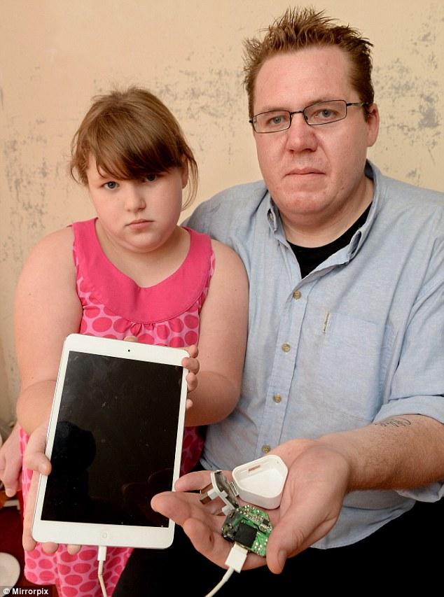 Bố con người đàn ông người Mỹ Tim Gillooley vẫn còn sợ hãi sau sự cố nổ sạc iPad