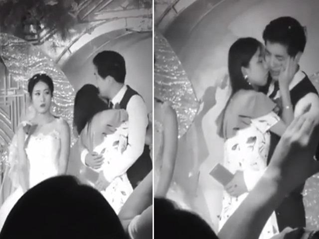 Bạn gái cũ lên sân khấu ôm hôn chú rể trong đám cưới, cô dâu bất lực đứng nhìn