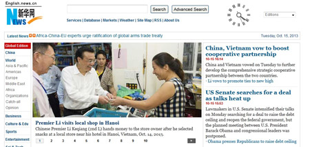 Hãng tin Tân Hoa Xã đưa lên trang đầu website  loạt ảnh Thủ tướng  Lý Khắc Cường đi mua hàng tại Hà Nội
