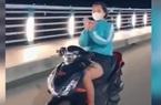 """Xử phạt cô gái chạy xe máy không đội mũ bảo hiểm, thả 2 tay... """"múa quạt"""""""