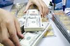 Giá USD tự do tăng vọt sau khi công bố tỷ giá trung tâm
