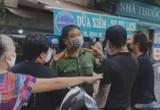 """Hà Nội: Chuyển hồ sơ vụ cặp vợ chồng định """"thông chốt"""" chợ Yên Phụ lên Công an quận"""