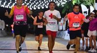 Ông Đoàn Ngọc Hải chinh phục VnExpress Marathon Hanoi Midnight