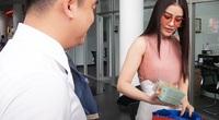 Á hậu ôm túi tiền mặt đi mua siêu xe bạc tỷ khiến dân mạng sốt sình sịch là ai?
