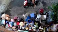 Bắt người phụ nữ chở con dàn cảnh trộm tiền của cụ bà bán tạp hoá