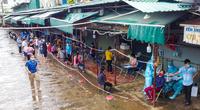 Áp dụng Chỉ thị 16: Cầm phiếu đi chợ sang phường khác mua lương thực có bị xử phạt không?