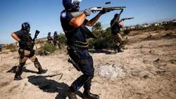 Cảnh sát dùng súng giải tán đám đông vào top ảnh thời sự trong tuần