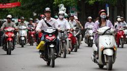 Có nên bắt buộc người đi xe máy bật đèn chiếu sáng ban ngày?