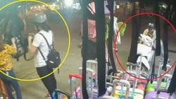 VIDEO: Cô gái mải chọn túi xách bị mất xe máy sau lưng