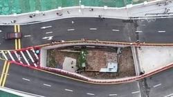 Clip: Kỳ lạ ngôi nhà tách cây cầu làm đôi ở Trung Quốc