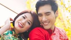 Trang Trần diện áo dài e ấp bên trai trẻ