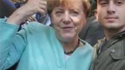 Xác định nhân vật chụp ảnh cùng bà Merkel gây tranh cãi