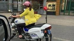 Cô gái mặc áo vàng đi xe đặc chủng CSGT là nhân viên sửa xe