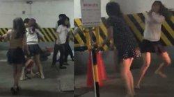 Bảo vệ xịt bình cứu hỏa ngăn các thiếu nữ hỗn chiến