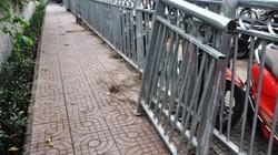 Cấp tốc cắt bỏ rào chắn vỉa hè như chuồng thú ở SG