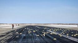 Hàng tấn vàng thỏi từ máy bay rơi xuống đường băng Nga
