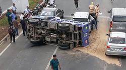 Xe tải lật ngang sau khi đụng đuôi xế hộp Mercedes ở Sài Gòn