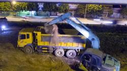 Ảnh: Công nhân trắng đêm xén dải phân cách đường vành đai 3 Hà Nội