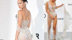 Người mẫu vất vả che chắn váy xẻ cao