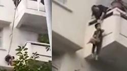 Kinh hoàng bà buộc dây thả cháu 7 tuổi từ tầng 5 để cứu con mèo