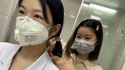 Nữ y tá Vũ Hán cùng nhau cắt tóc chống chọi virus Corona gây xúc động