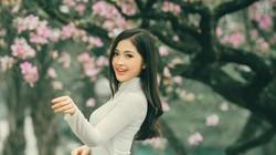Nữ sinh Điện ảnh đẹp nao lòng giữa con phố ngập tràn sắc tím hoa ban