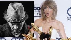 """Nhiếp ảnh gia tố Taylor Swift bóc lột """"phó nháy"""""""